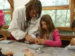 4-H youth leader assisting 4-H youth