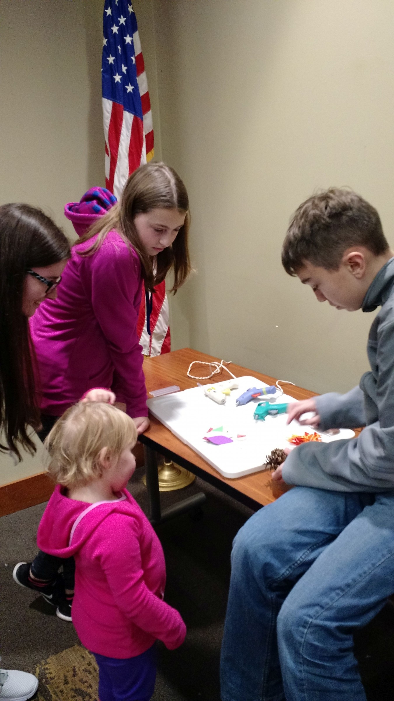 Four children working on a craft project