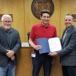 County Board Chairman Kriefall, Paul Roback, and County Executive Schoemann